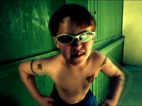 medium shot boy with sunglasses and tattoos flexing muscles + making faces at camera / mexico city - flexing muscles stock videos and b-roll footage