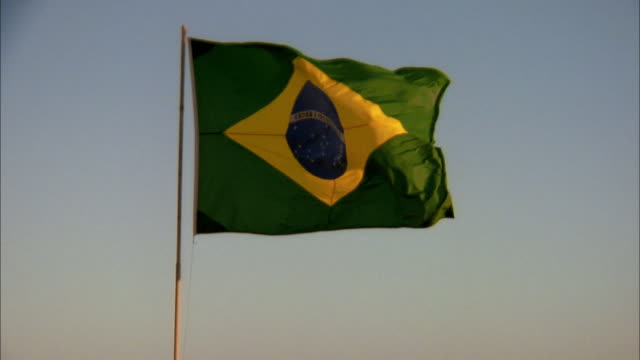 medium shot brazilian flag waving outdoors - flag stock videos & royalty-free footage