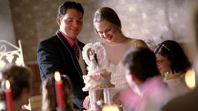Medium Shot Bride And Groom Cutting Wedding Cake High Res Stock Video Footage Getty Images