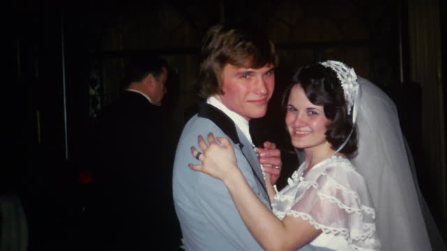1974 medium shot bride and groom dancing at wedding reception / band playing in background - wedding stock videos & royalty-free footage
