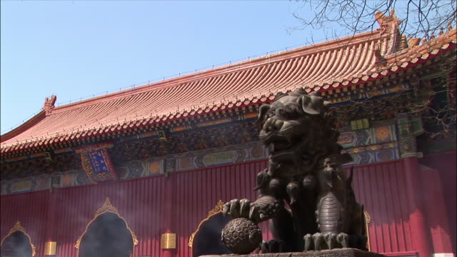 medium shot bronze sculpture and incense at lama temple/ beijing, china - imperial lion stock videos and b-roll footage
