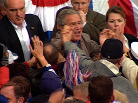 2004 medium shot Bush shaking hands with crowd of supporters at campaign rally / Hershey Pennsylvania