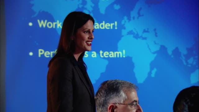 medium shot business woman giving presentation in board room/ new york, new york - strategia di vendita video stock e b–roll