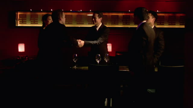 medium shot businessman arriving at business dinner and shaking hands - business lunch stock videos & royalty-free footage