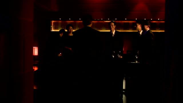 Medium shot businessman arriving at business dinner and shaking hands