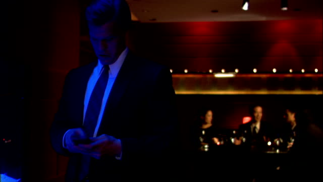 medium shot businessman texting on pda in restaurant before rejoining business meeting - electronic organiser stock videos & royalty-free footage