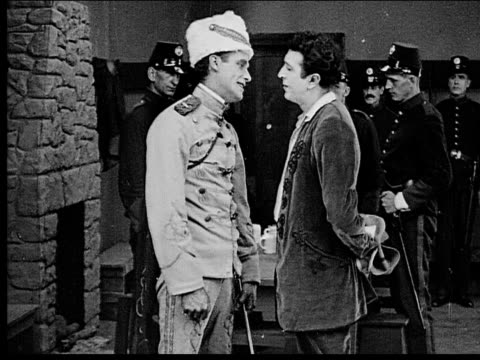 1916 b/w medium shot captured man and woman being brought into military headquarters and separated - 1916 stock videos & royalty-free footage