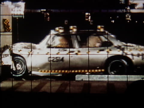 1972 medium shot car crashing into wall in crash test / audio - danger stock videos & royalty-free footage