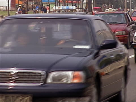 2004 medium shot cars in heavy traffic on street / bejing china - londonalight stock videos and b-roll footage