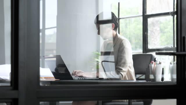 medium shot, caucasian woman types at desk - composite image stock videos & royalty-free footage