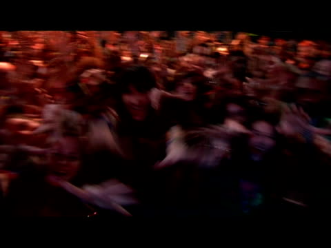 medium shot pov of celebrity on stage as fans reach up with grabbing hands/ london, england - arms raised stock videos & royalty-free footage