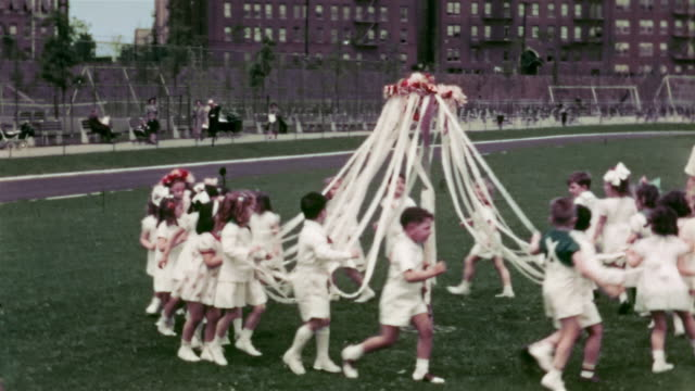 1938 medium shot children dancing around maypole in the park - may day international workers day stock videos & royalty-free footage