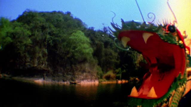 medium shot chinese waterdragon boat passing on river / china - mythology stock videos & royalty-free footage