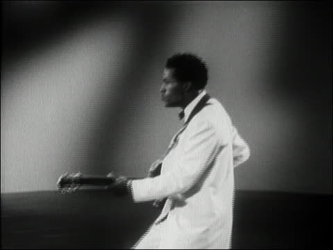 1956 medium shot chuck berry doing the 'duck walk' while performing 'you can't catch me' / audio - early rock & roll stock videos and b-roll footage