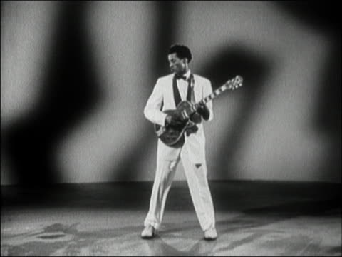 vídeos de stock e filmes b-roll de medium shot chuck berry performing 'you can't catch me' from 'rock, rock, rock' film / audio - 1956