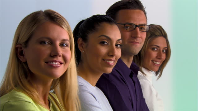 medium shot - close-up four customer service representatives sitting side by side - side by side stock videos & royalty-free footage