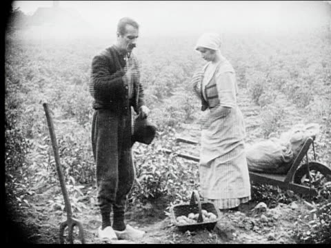 1916 b/w medium shot- close-up montage farmer and wife praying in field/ nun pulling rope in belfry/ church bell ringing side to side/ young nun praying in garden - bell stock videos and b-roll footage