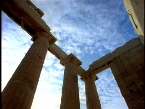 1996 medium shot clouds floating above ruins of ancient greek temple/ greece - ancient greece stock videos & royalty-free footage