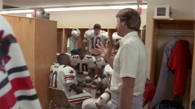 1985 Medium shot Coach Steve Spurrier talking to Tampa Bay Bandits football players in locker room before game / USA