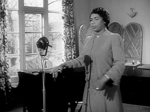 Medium shot Contralto singer Marian Anderson and her pianist recording in her home studio/ Danbury Connecticut USA