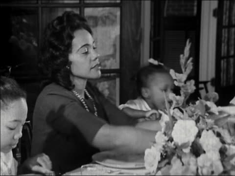 1964 medium shot coretta scott king at dinner table - georgia stati uniti meridionali video stock e b–roll
