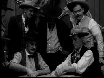 1915 b/w medium shot cowboys playing poker in gambling saloon  - poker stock-videos und b-roll-filmmaterial