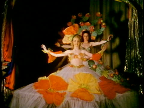 medium shot dancers walking onstage w/elaborate skirts w/large flowers and headdress w/arms outstretched - headdress stock videos & royalty-free footage