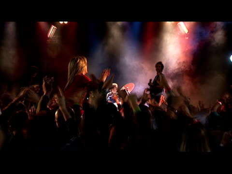 medium shot drummer playing on stage as people clap in foreground/ zoom out medium shot woman sitting on man's shoulders in crowd and clapping/ zoom in drummer/ london, england - shoulder ride woman stock videos & royalty-free footage