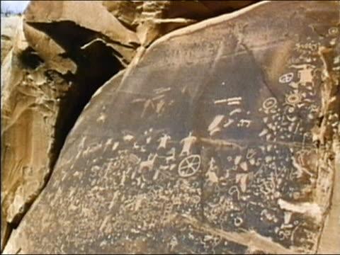 1975 medium shot elaborate carvings on rock / mesa verde, colorado - mesa verde national park stock videos & royalty-free footage