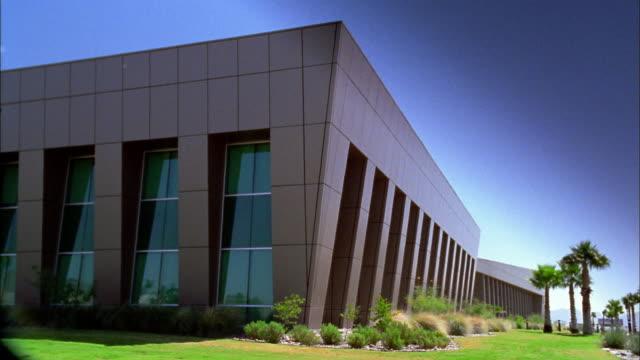 Medium shot exterior corner of modern office building