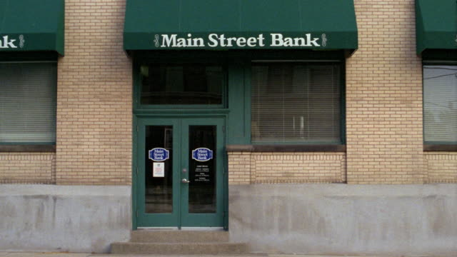medium shot exterior of main street bank / wheeling, west virginia - bank financial building stock videos and b-roll footage