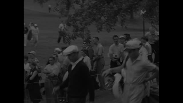 medium shot fairway with golfer putting / various shots crowd / australian golfer peter thomson tees off / cary middlecoff tees off / ben hogan tees... - hole stock videos & royalty-free footage