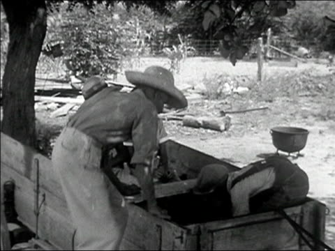 1942 medium shot family loading horsedrawn cart, getting in, and riding off/ macon, georgia/ audio - horse cart stock videos and b-roll footage