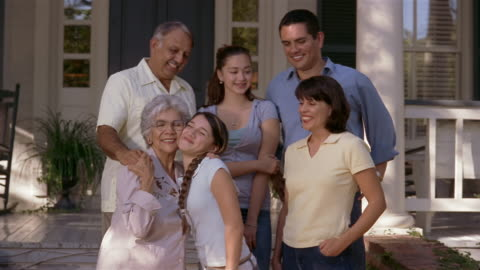 medium shot family portrait in front of house/ san antonio, texas - in front of stock videos & royalty-free footage