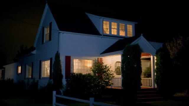 medium shot farmhouse at night w/lights on in front porch and interior / monroe / wa - establishing shot stock videos & royalty-free footage