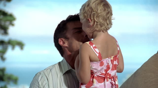 medium shot father holding daughter and teasing her / somerset west, south africa - primary age child stock videos and b-roll footage
