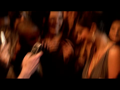 medium shot female celebrity meeting fans and signing autographs on red carpet/ london - autographing stock videos & royalty-free footage
