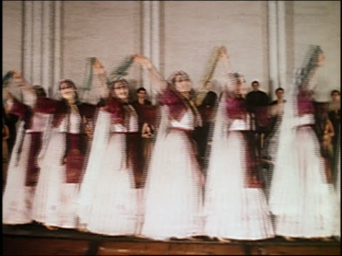 1967 medium shot female dancers crossing the stage with tiny steps / audio / armenia - choir stock videos and b-roll footage