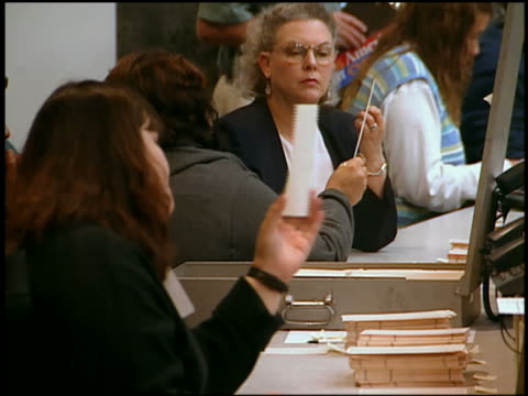 2000 medium shot female election workers counting votes by hand / Florida
