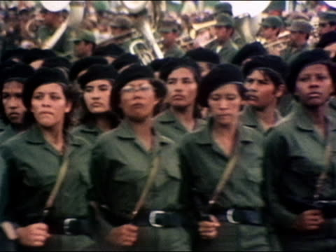 1980 medium shot female nicaraguan army soldiers marching past cam / nicaragua / audio - nicaragua stock videos & royalty-free footage