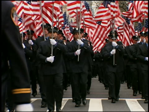 medium shot firefighters in dress uniforms carry american flags in st. patrick's day parade / nyc - 20 29 years stock videos & royalty-free footage