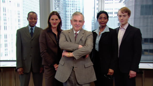 "medium shot five office workers standing in ""v"" formation/ boss folding his arms and smiling/ four other people folding arms/ new york, new york - five people stock videos & royalty-free footage"