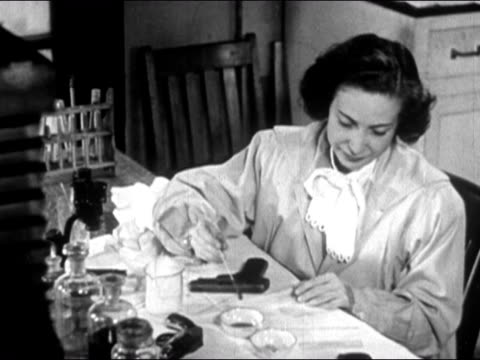 1947 medium shot forensic scientist applying acid to gun with cotton swab to reveal defaced serial number/ dearborn, michigan - cotton bud stock videos & royalty-free footage