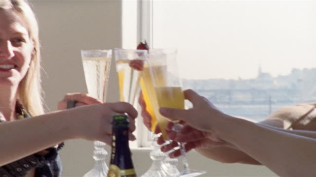medium shot four women toasting and drinking champagne/ san francisco, california - female friendship stock videos & royalty-free footage