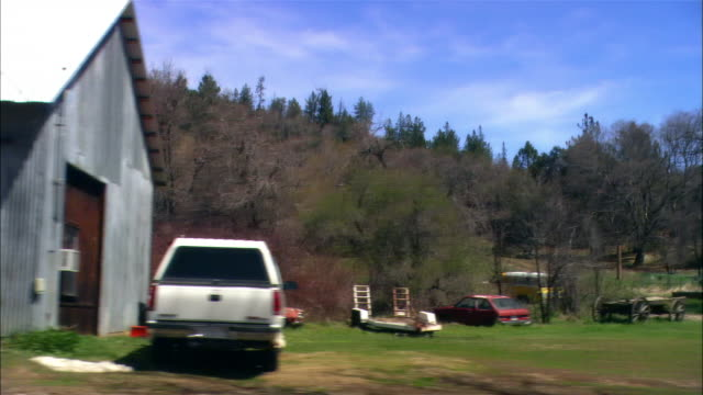 medium shot pov from moving car driving through small town, past fire station, shops, houses, parked cars, julian, california - tracking shot stock videos & royalty-free footage