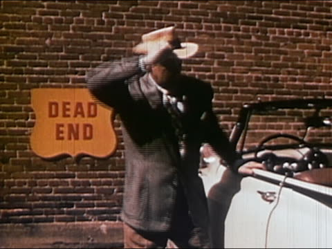 "1952 medium shot frustrated driver slamming car door and throwing hat down at ""dead end"" sign / AUDIO"