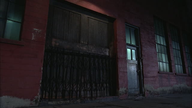 medium shot gate over entrance to warehouse / night - 1984 stock videos & royalty-free footage