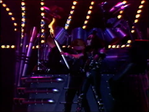 1982 medium shot gene simmons in makeup 'breathing fire' with torch on stage during concert by rock band kiss - lycra stock videos & royalty-free footage