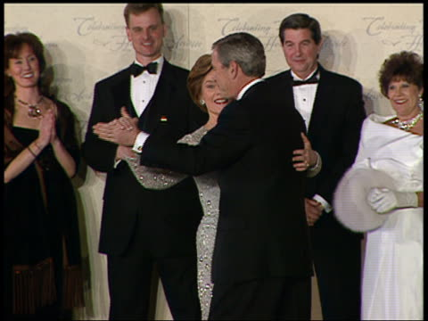 vídeos y material grabado en eventos de stock de medium shot george w. and laura bush dancing on stage at inaugural ball / audio / washington dc - 2005