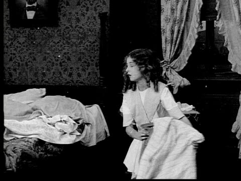 1913 b/w medium shot girl moving chair and making bed in bedroom / usa  - 1913 stock videos & royalty-free footage